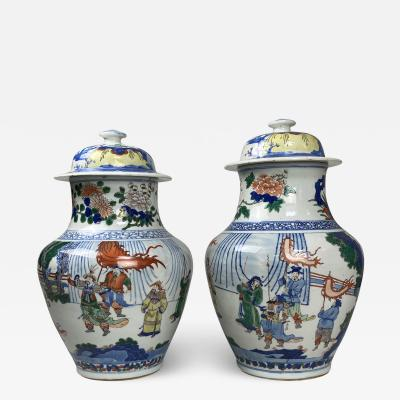 A decorative pair of Antique Chinese Wucai jars and covers
