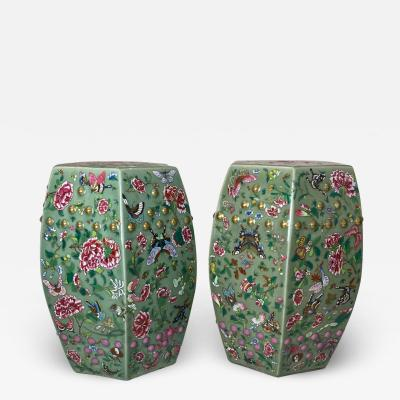 A decorative pair of Chinese nineteenth Century famille rose garden stools