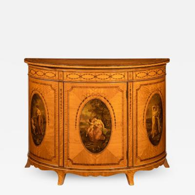 A fine Victorian Sheraton revival West Indian satinwood demi lune commode