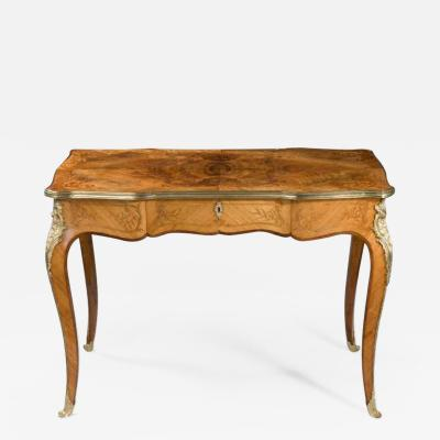 A fine mid Victorian burr walnut writing table