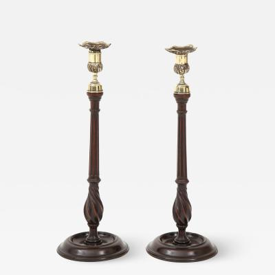 A fine pair of mahogany candlesticks with brass nozzles circa 1830