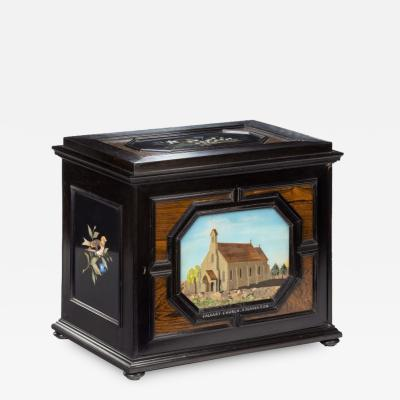 A fine quality ebony bijouterie table cabinet showing Cavalry Church