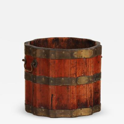 A fluted vintage wine barrel or bucket with brass bands and handles