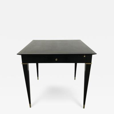 A game table ebonized mahogany bronze details and leather top