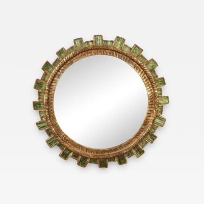 A gilt carved Sunburst mirror convex Surrounded by green faceted glass