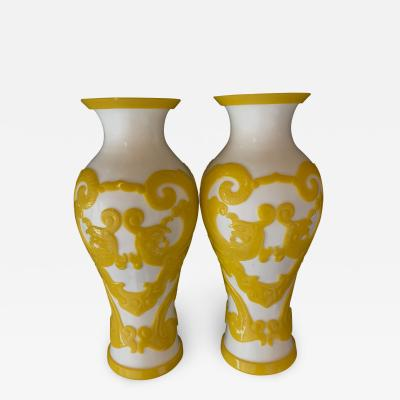 A good quality pair of Chinese Imperial yellow over white baluster form vases