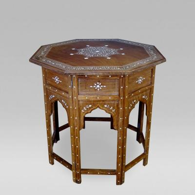 A handsome and intricately inlaid Anglo Indian octagonal traveling table