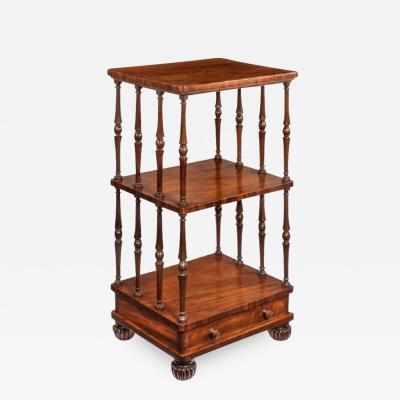 A late Regency mahogany three tier
