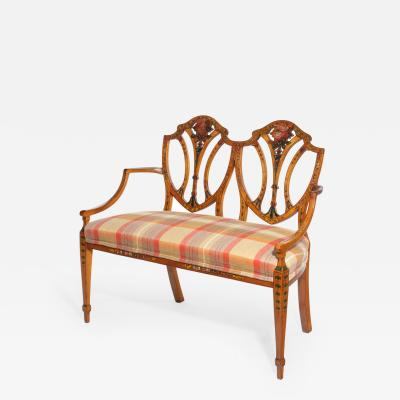 A late Victorian Sheraton revival painted satinwood two seater settee