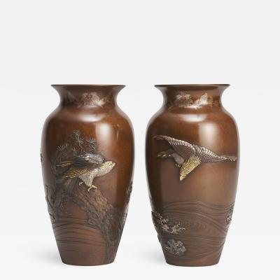 A magnificent pair of Japanese Bronze inlaid and onlaid vases