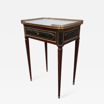 A mahogany and bronze signed table Louis XVI period France XVIIIth century