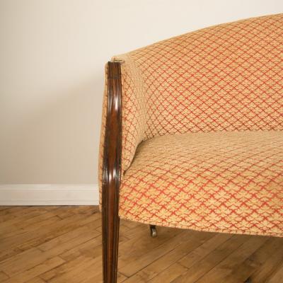 A mahogany framed Georgian sofa on six tapered legs on brass casters England