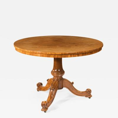 A mid Victorian faded satinwood centre table