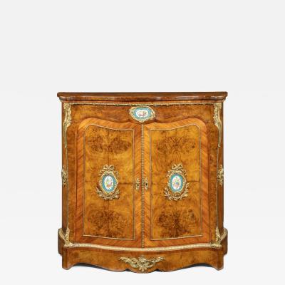 A mid Victorian kingwood serpentine cabinet