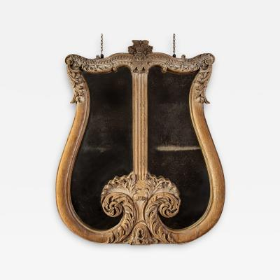 A monumental lyre shaped overmantle mirror