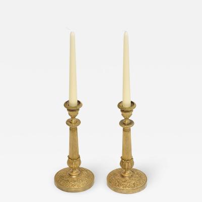 A pair of 19th c gilt bronze Empire candlesticks