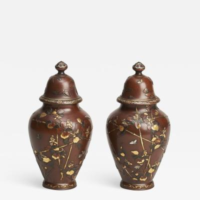 A pair of Antique Japanese miniature jars and covers