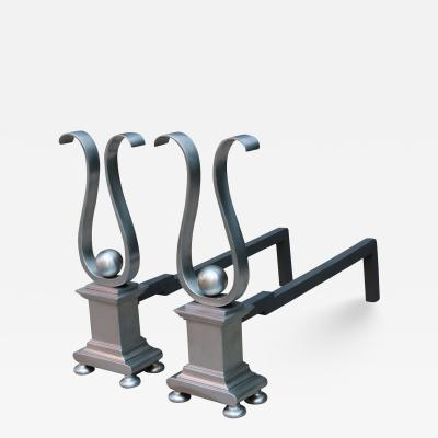 A pair of Architectural Andirons Patinated metal