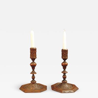 A pair of Bois de Saint Lucie Candlesticks