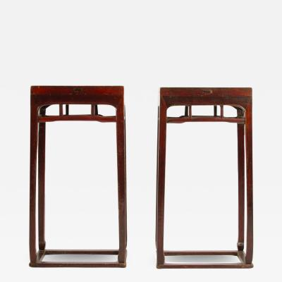 A pair of Chinese hardwood tall side tables pedestals circa 1900