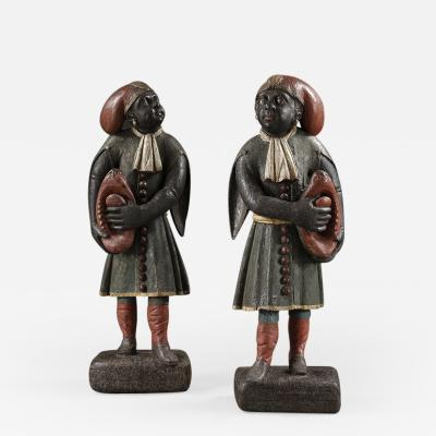 A pair of Dutch East Indian figures