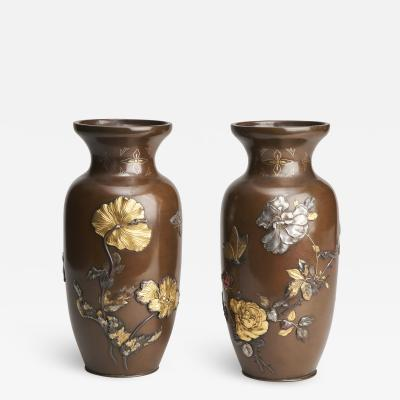 A pair of Japanese Meiji period Bronze vases