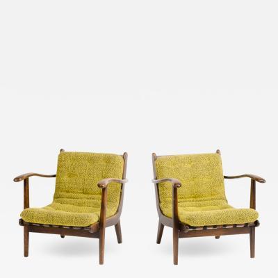 A pair of Mid Century Italian oak armchairs circa 1945
