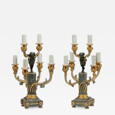A pair of Napoleon III six light candelabra