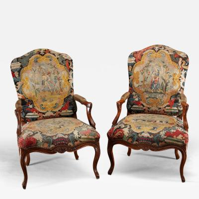 A pair of Regence Walnut Fauteuil ca 1720