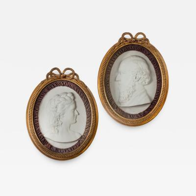 A pair of Victorian marble portrait plaques