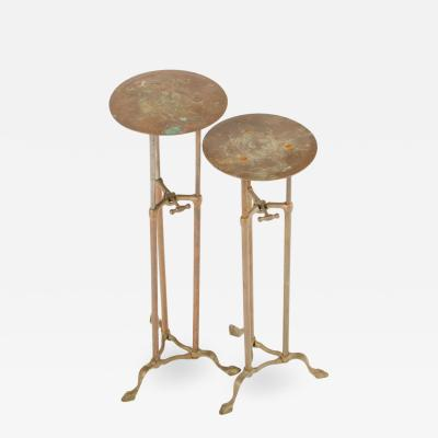 A pair of brass and iron adjustable plant stands circa 1910