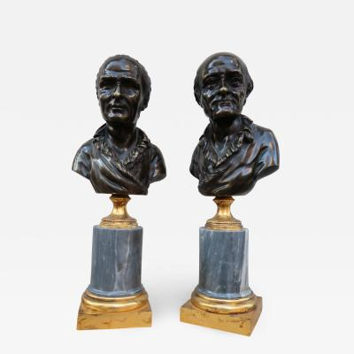 A pair of bronze and marble busts France XVIIIth century