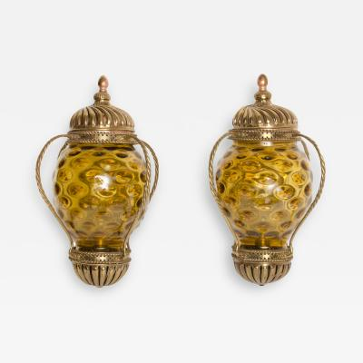 A pair of carriage lantern style wall sconces circa 1890