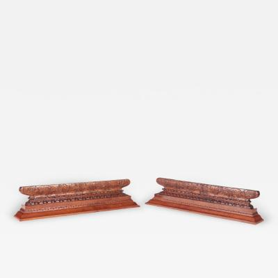 A pair of carved mahogany mantle shelves or overdoors circa 1910