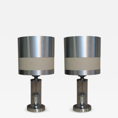A pair of chromed steel table lamps Italy 70