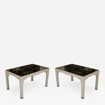 A pair of lacquered and brass coffee tables France 70