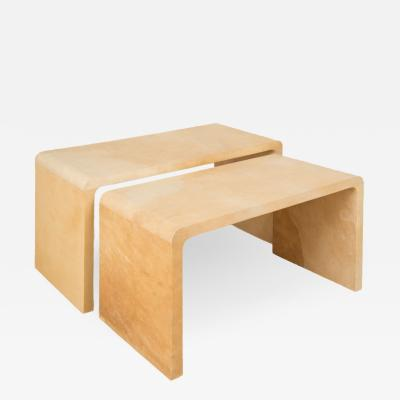A pair of nesting parchment coffee tables in the manner of Jean Michel Frank