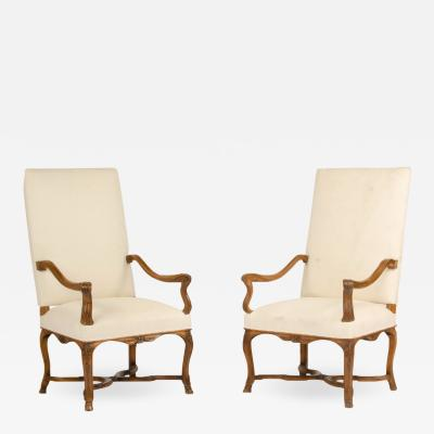 A pair of tall French walnut armchairs circa 1900