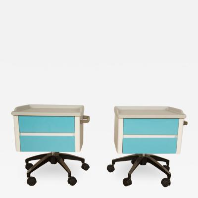 A pair of white and blue two drawers side cabinets on rolling base 1970s