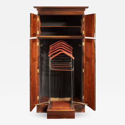 A rare Edwardian mahogany mechanical gentleman s wardrobe