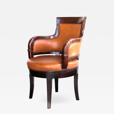 A rare and handsome French empire walnut leather upholstered swivel desk chair