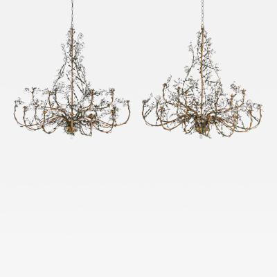 A rare and monumental pair of oval 1940 s Italian chandeliers