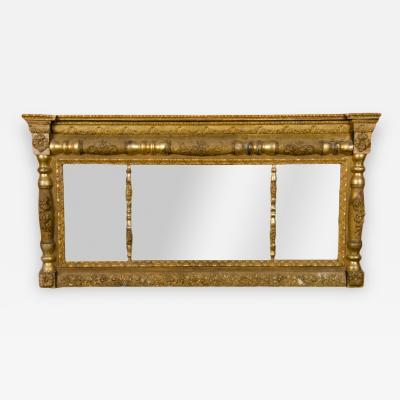 A richly carved giltwood Trumeau mirror 19th C