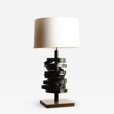 A sculptural modernist table lamp by Leonard Mendoza