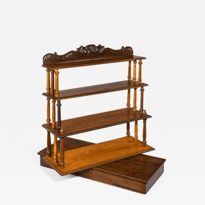 A set of Anglo Ceylonese specimen wood campaign wall shelves in a travelling box