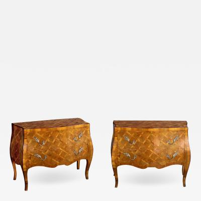 A shapely pair of Italian rococo style olive wood chests with parquetry inlay