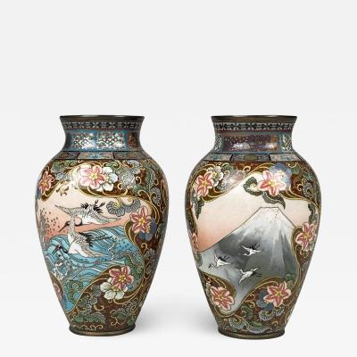 A small yet dramatic pair of late 19th Century Japanese cloisonne vases