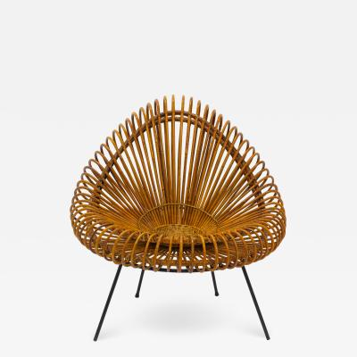 A stylish rattan and iron chair designed by Janine Abraham