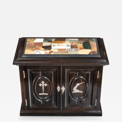 A superb early Victorian ebony collector s cabinet