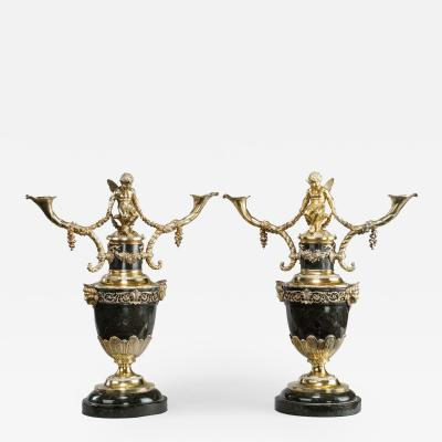 A superb pair of Victorian silver gilt candelabra